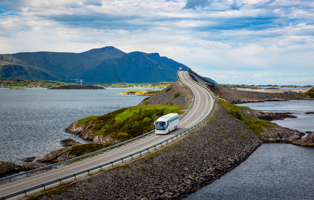 Tourist bus traveling on the road in Norway. Atlantic Ocean Road or the Atlantic Road (Atlanterhavsveien) been awarded the title as Norwegian Construction of the Century. Stock Photo