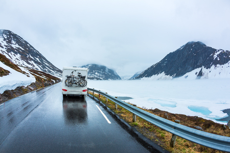 Caravan car travels on the highway. Beautiful Nature Norway natural landscape. Standard-Bild