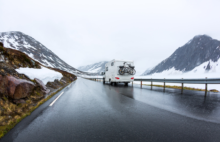 Caravan car travels on the highway. Beautiful Nature Norway natural landscape. Stock Photo