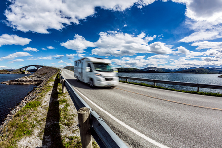 Caravan car RV travels on the highway Norway. Atlantic Ocean Road or the Atlantic Road (Atlanterhavsveien) been awarded the title as (Norwegian Construction of the Century). Stock Photo
