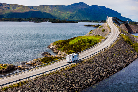 Caravan car RV travels on the highway Norway. Atlantic Ocean Road or the Atlantic Road (Atlanterhavsveien) been awarded the title as (Norwegian Construction of the Century).