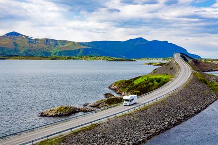 Caravan car RV travels on the highway Norway. Atlantic Ocean Road or the Atlantic Road (Atlanterhavsveien) been awarded the title as (Norwegian Construction of the Century). Stock Photo