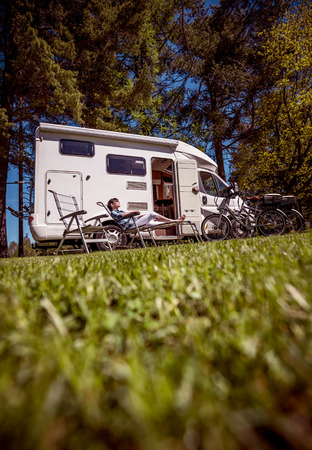 Woman resting near motorhomes in nature. Family vacation travel, holiday trip in motorhome RV, Caravan car Vacation. Stock Photo - 94065952