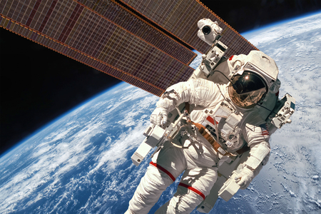 International Space Station and astronaut in outer space over the planet Earth. Stock Photo