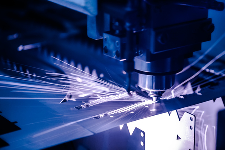 CNC Laser cutting of metal, modern industrial technology. Small depth of field. Warning - authentic shooting in challenging conditions. Stockfoto
