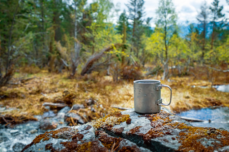 Travel titanium cup. Lunch during the journey to the wild. Camping lifestyle Beautiful Nature Norway. Imagens