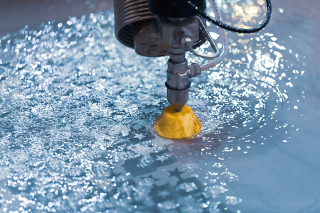 CNC water jet cutting machine modern industrial technology. 스톡 콘텐츠