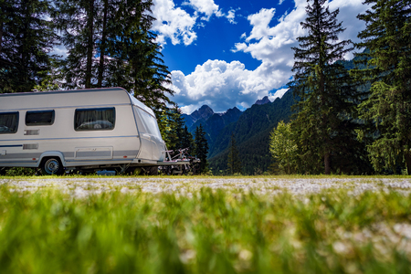 Family vacation travel, holiday trip in motorhome RV, Caravan car Vacation. Beautiful Nature Italy natural landscape Alps. Stock Photo - 107496040