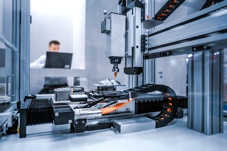 CNC Laser cutting of metal, modern industrial technology. Small depth of field. Warning - authentic shooting in challenging conditions. Stock Photo