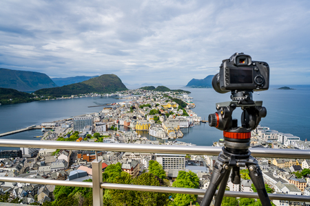 Aksla at the city of Alesund , Norway. It is a sea port, and is noted for its concentration of Art Nouveau architecture. Camera on a tripod on the observation deck.
