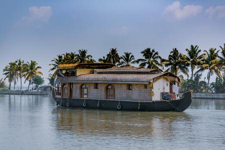 House boat sailing through Kerala backwaters 写真素材