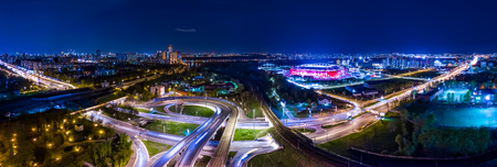 Night Aerial view panorama of a freeway intersection traffic trails in night Moscow