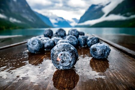 Blueberry antioxidants on a wooden table on a  of Norwegian nature.