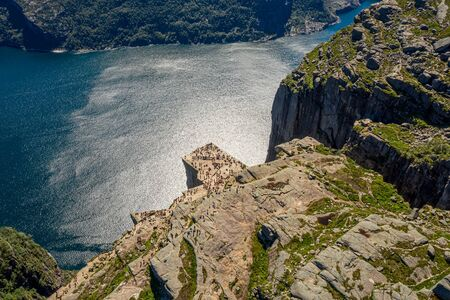 Preikestolen or Prekestolen, also known by the English translations of Preacher's Pulpit or Pulpit Rock 写真素材 - 128817222