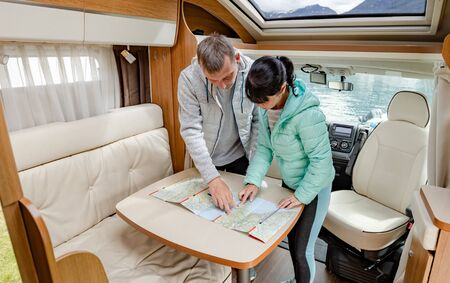 Couples in RV Camper looking at the local map for the trip. 写真素材 - 128817236