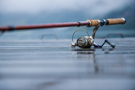 Fishing rod spinning blurred Banco de Imagens