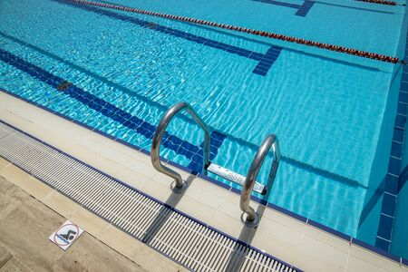 Olympic Swimming pool background on a bright Sunny day