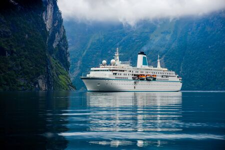 Cruise Ship, Cruise Liners On Geiranger fjord, Norway. 写真素材 - 130315949