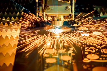CNC Laser cutting of metal modern industrial technology. Laser cutting works by directing the output of a high-power laser through optics. Laser optics and CNC computer numerical control. 写真素材 - 131393337