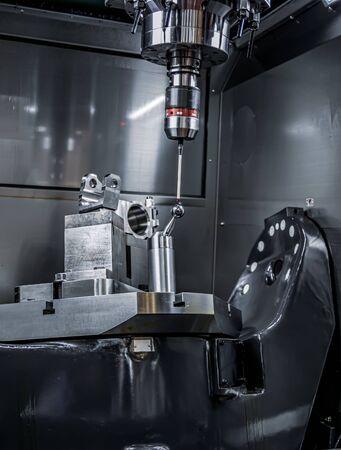 Quality control measurement probe. Metalworking CNC milling machine. Cutting metal modern processing technology. 写真素材 - 131393465