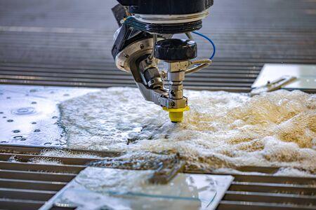 CNC water jet cutting machine modern industrial technology. 写真素材 - 131393508