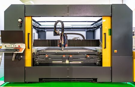 CNC Laser cutting of metal modern industrial technology. Laser cutting works by directing the output of a high-power laser through optics. Laser optics and CNC computer numerical control. 写真素材 - 131393772