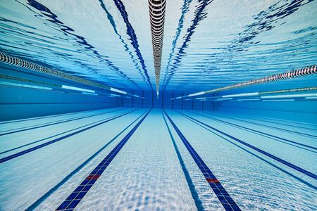 Swimming pool underwater background. Imagens