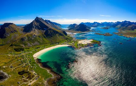 Panorama Beach Lofoten islands is an archipelago in the county of Nordland, Norway. Is known for a distinctive scenery with dramatic mountains and peaks, open sea and sheltered bays, beaches Stock Photo
