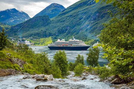 Cruise Ship, Cruise Liners On Geiranger fjord, Norway. The fjord is one of Norway's most visited tourist sites. Geiranger Fjord