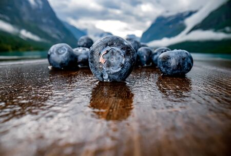 Blueberry antioxidants on a wooden table Banco de Imagens