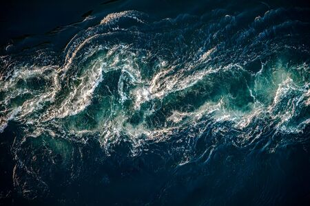 Waves of water of the river and the sea meet each other during high tide and low tide.