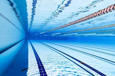 Swimming pool underwater background.