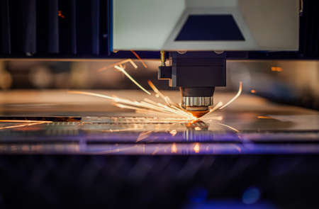 CNC Laser cutting of metal modern industrial technology. Laser cutting works by directing the output of a high-power laser through optics. Laser optics and CNC computer numerical control. Standard-Bild