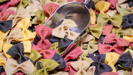 Colored Farfalle Pasta bow tie pasta background.