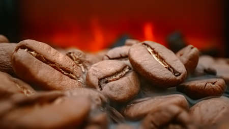 Close up of seeds of coffee. Fragrant coffee beans are roasted smoke comes from coffee beans. Standard-Bild