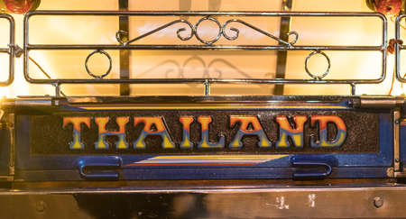 Car tag of Tuk-Tuk native taxi in Thailand. This is a symbol of the taxi in Bangkok city. This symbol of the old patterns of ancient Thailand.