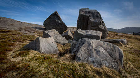 rugged terrain: Multiple boulders making a scenic landscape on a hill. Taken in Flatrock, Newfoundland and Labrador