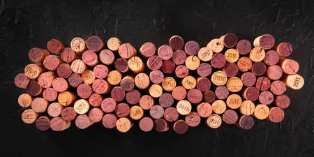 Wine corks panorama on a black background, shot from the top