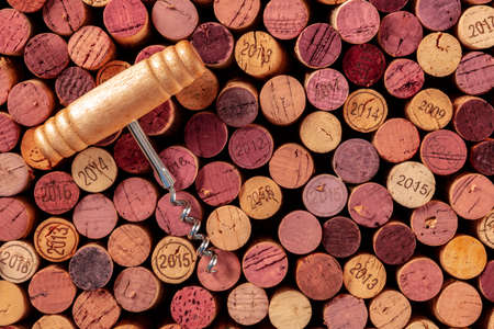 Wine corks with a vintage corkscrew, shot from the top