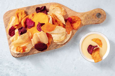 Vegetable chips with a dip, overhead shot with copy space