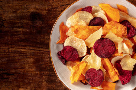 Healthy vegetable chips, close-up with a place for text Foto de archivo
