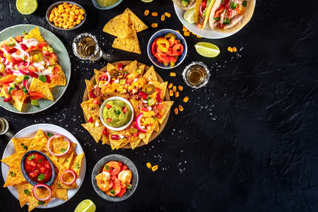 Mexican food overhead flat lay shot on a black slate background