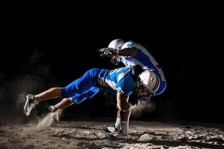 アメリカのフットボール夜アクション 写真素材