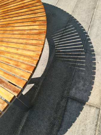 strong light: Shadow of outdoor curved bench in strong light