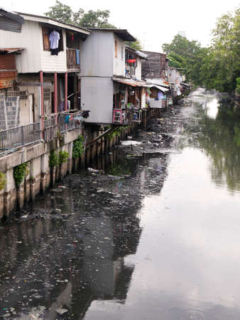 littering: Littering and dirty canal Pollution Stock Photo