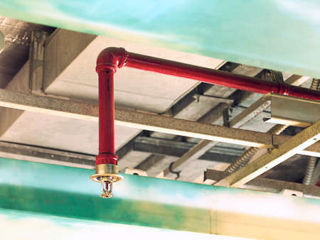 department head: Automatic Fire Sprinkler in red water pipe System Stock Photo