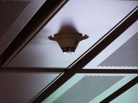 smoke detector install on high aluminum ceiling  DRAMATIC LOW KEY Photography style Stock Photo