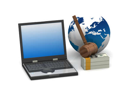 judges court gavel on a laptop computer and dollar  photo
