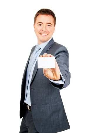 Confident young man holding blank copy space business card on isolated background photo
