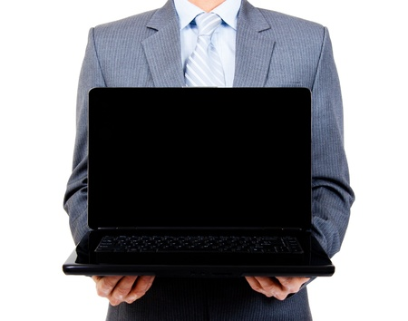 Business man holding a blank laptop for copy space on isolated backgroun photo